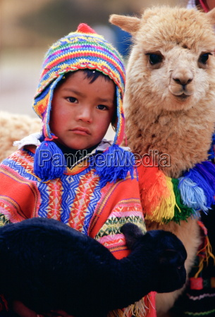 peruvian boy with black lamb and
