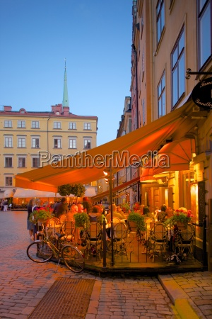 stortorget square cafes at dusk gamla