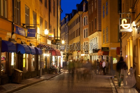 busy street at dusk gamla stan