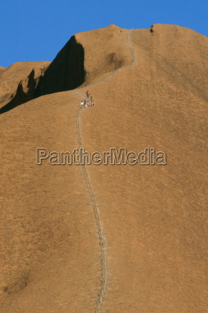 tourists visiting ayers rock in australia