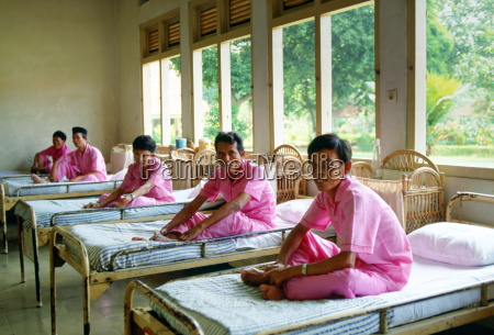 men suffering from leprosy are cared