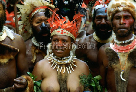 bare breasted tribeswoman and tribesmen wearing