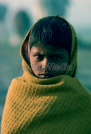 boy wrapped against the chill morning