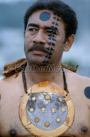 fijian warrior withhis face painted in