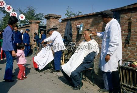 men at work at an outdoor