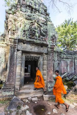 buddhist monks at ta prohm temple