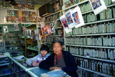 woman and child in video shop