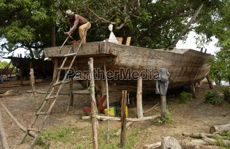 carpenter building a boat zanzibar