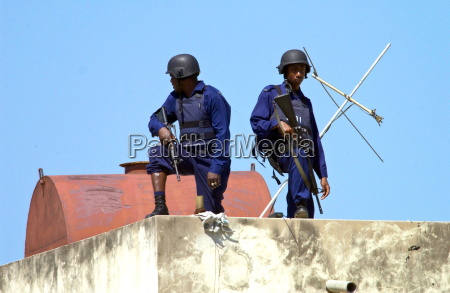 security guards armed with guns and