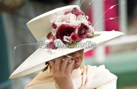 race goer wearing a cream hat