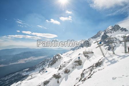 jade dragon snow mountain with blue