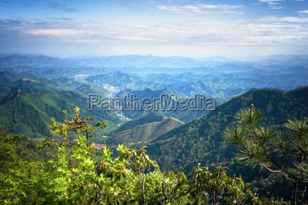 misty mountain chains and valley with
