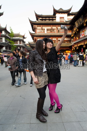 tourists taking their own photograph at