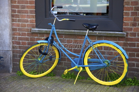 blue and yellow bicycle amsterdam netherlands