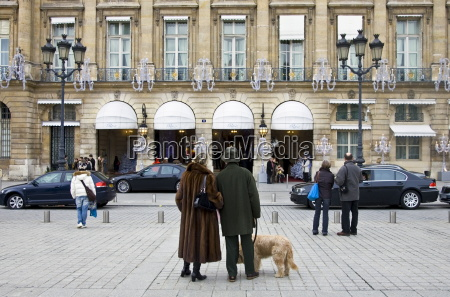 couple with dog gaze at ritz