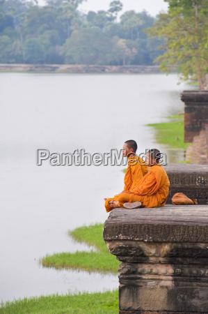 buddhist monks sitting at angkor wat