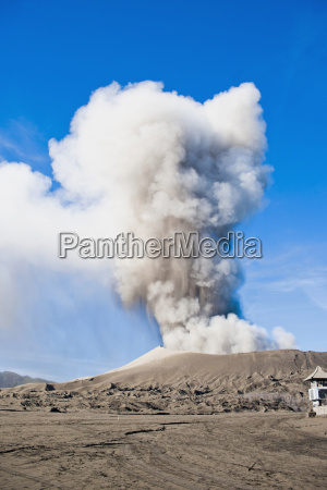 mount bromo volcanic eruption sending up