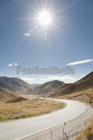 long winding road through a valley