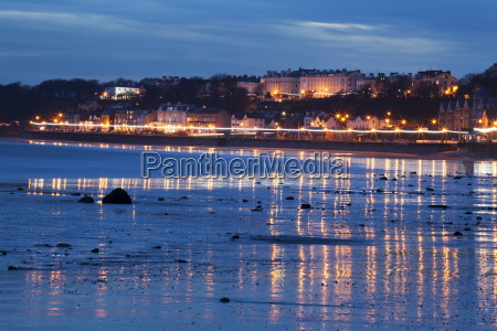 seafront illuminations reflected on wet sands