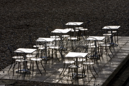 deserted tables and chairs out of