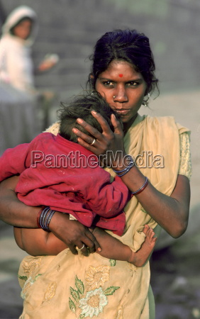 mother holding her young baby as