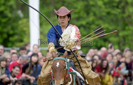 japanese horseman displaying his skill with
