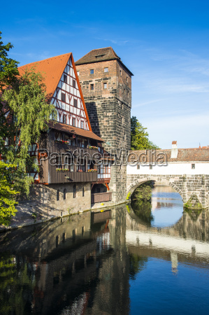 old timbered houses and hanging tower