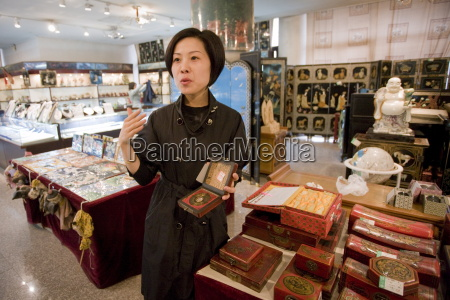 chinese woman selling feng shui compass