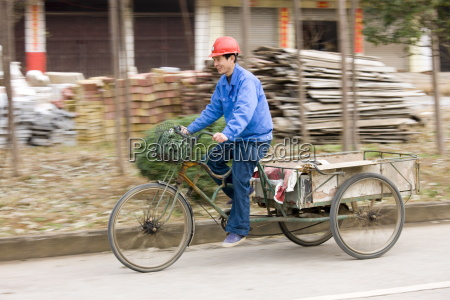 man with delivery cart on market