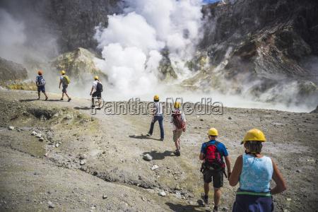 tourists exploring white island volcano an