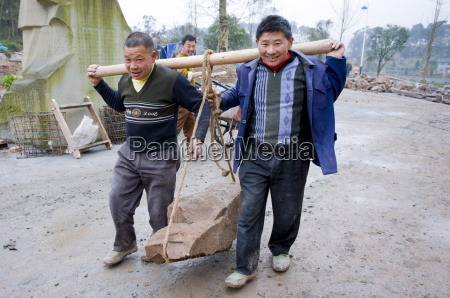 men at work building new tourist