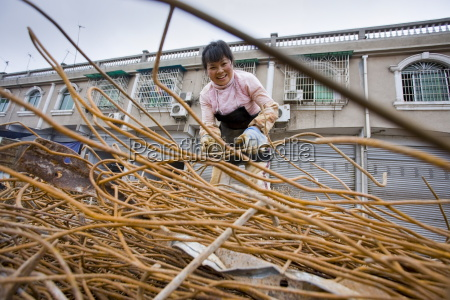 woman working at metal recycling steel