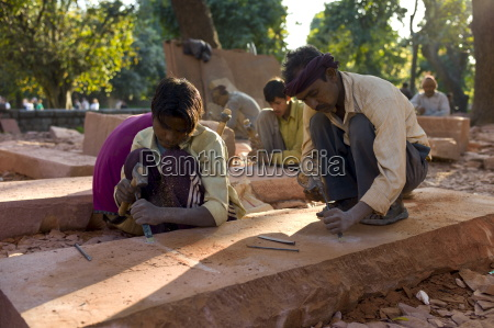 stonemasons using traditional manual skills at