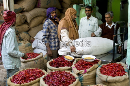 businessmen and porters at stall selling
