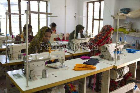 indian women sewing textiles at dastkar