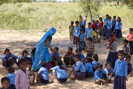 indian schoolchildren attending school at doeli