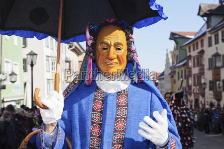 man in traditional costume schantle narrensprung
