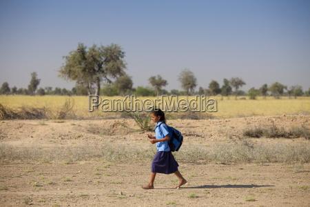 young indian girl in school uniform
