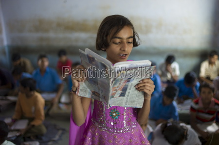 indian girl reading aloud during english
