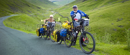 cyclists on roadway through wrynose pass