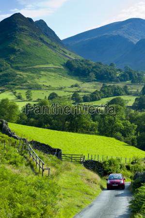 motoring holiday tourists driving through cumbrian