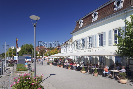 promenade with restaurant and street cafe