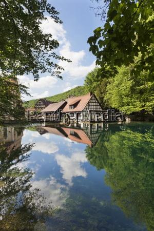 mill reflecting in blautopf spring blaubeuren