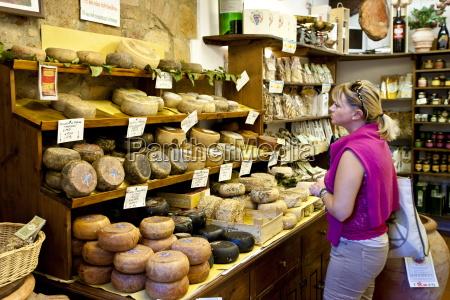 shopper in italian artisan cheese shop