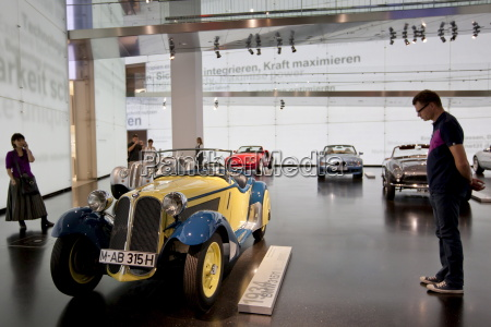 visitor at bmw museum views bmw