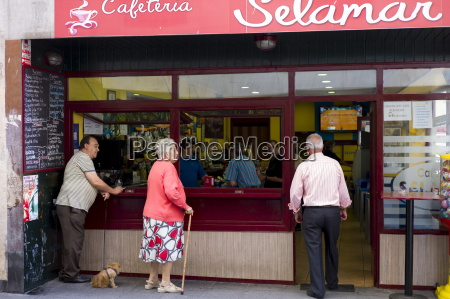 local spanish people at cafeteria in
