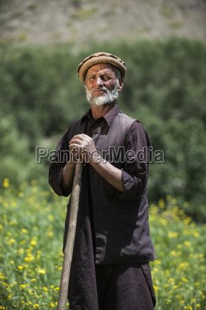a farmer standing in a wheat