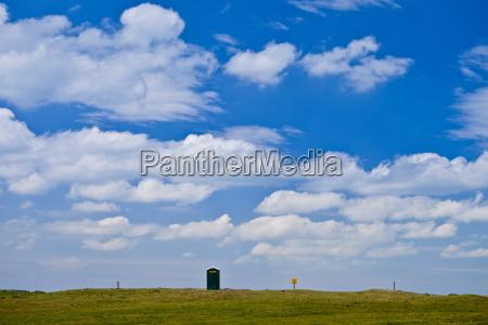 portable toilet in field in county