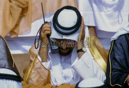 arab using two way radio to