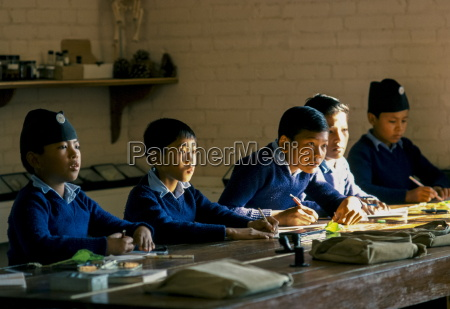 schoolboys attending lessons at a school